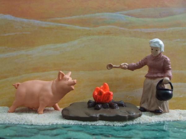 'Little Settlers' - Großmutter kocht am Feuer