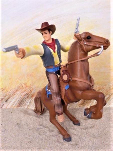 Reitender Cowboy ... schießend