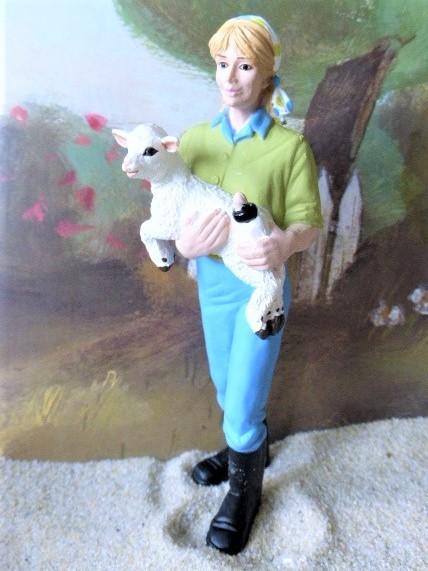 Junge Bauersfrau ... mit Lamm