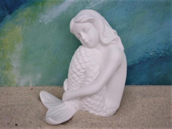 Sitzende Meerjungfrau aus weißem Bisquitporzellan