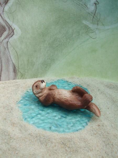 Schwimmender Fischotter... rotbraun