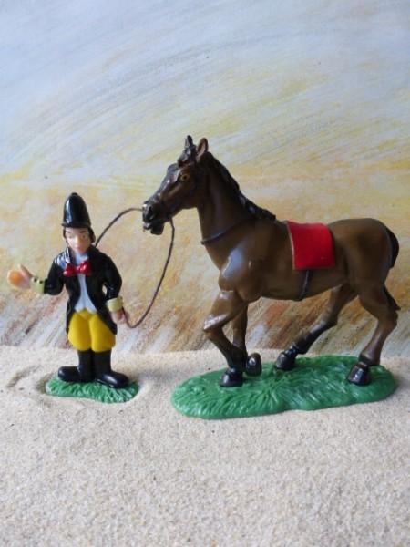 'Auf der Rennbahn' - Jockey mit braunem Pferd