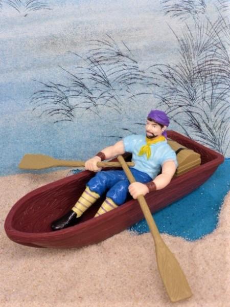 Pirat im Ruderboot ... mit Schatzkiste