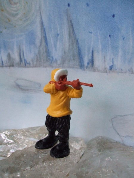 Schießender Inuit: gelb-schwarze Bekleidung